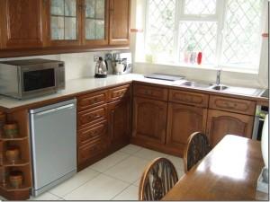 simpson varnished kitchen furniture.